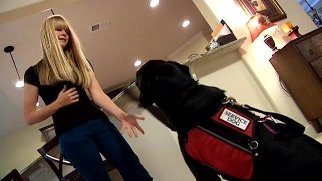 Kaelynn Partlow with her service dog Sabrina. (Oct. 7, 2013/FOX Carolina)