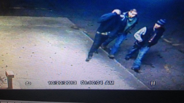 Surveillance video from Skateland shows the three suspects walk towards the cars. (Oct. 20, 2013/Skateland USA)