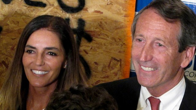 Maria Belen Chapur and her fiancee, former South Carolina Gov. Mark Sanford pose for a picture in Mount Pleasant, S.C., on Tuesday, April 2, 2013, after Sanford won the GOP nomination for the U.S. House seat he once held. (AP Photo/Bruce Smith)
