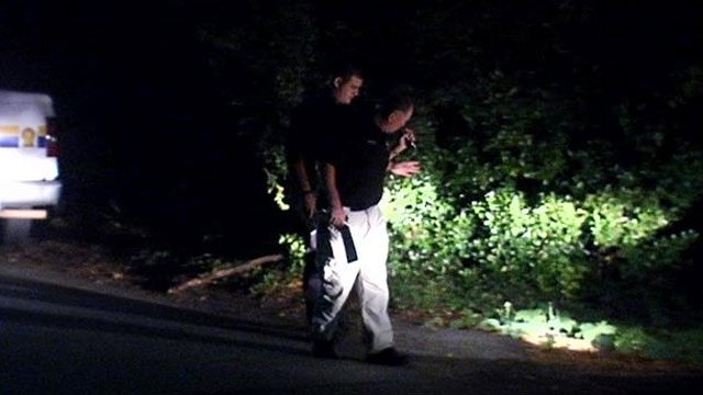 Deputies investigate the shooting scene. (Oct. 21, 2013/FOX Carolina)