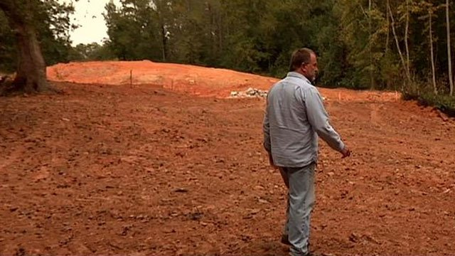 Developer Mark Clayton walks around the land he hopes to build on. (Oct. 23, 2013/FOX Carolina)