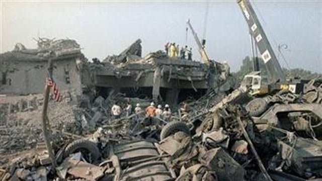 FILE -This Sunday, Oct. 23, 1983 file photo shows the aftermath of a suicide truck bombing of the U.S. barracks in Beirut. (AP Photo/Jim Bourdier, File)