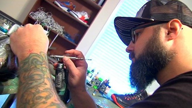 Troy Cole works on a custom pair of shoes. (Oct. 24, 2013/FOX Carolina)