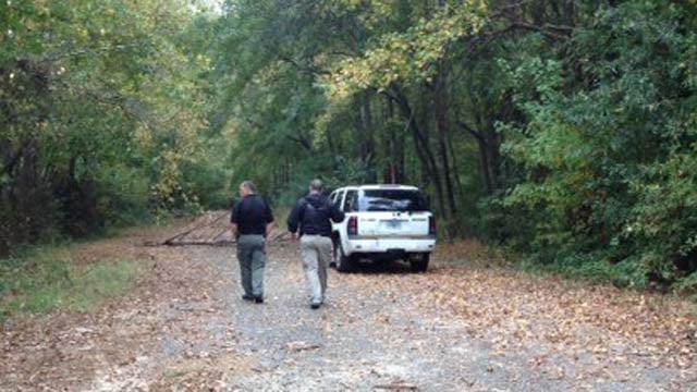 Forensics investigators along Whispering Pines Road. (Oct. 31, 2013/FOX Carolina)