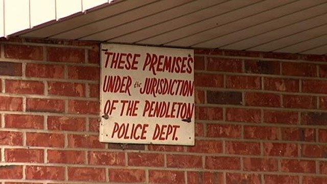 A sign still hangs outside of the Plez-U about the former police department. (Nov. 5, 2013/FOX Carolina)