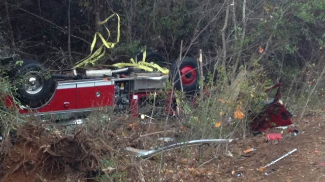 The overturned fire truck down an embankment along Pleasant Grove Road. (Nov. 11, 2013/FOX Carolina)