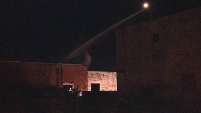 Firefighters attempting to put out the fire at the mill in Greenville. (Nov. 13, 2013/FOX Carolina)