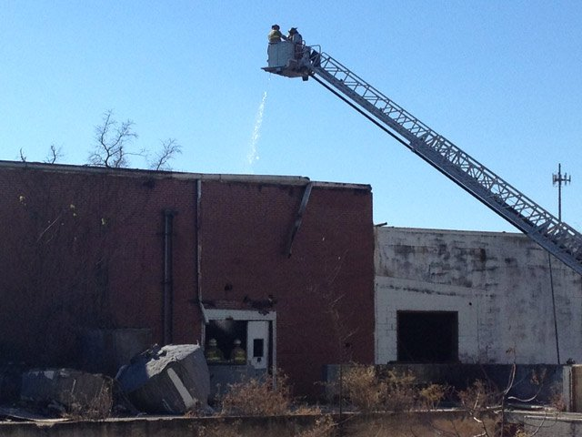 Firefighter back out at the mill putting out hot spots. (Nov. 14, 2013/FOX Carolina)