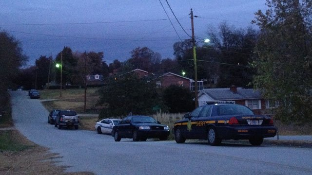 Deputies respond to the area of Crest St. where they say a man fired shots and would not come out of his home. (Nov. 15, 2013/FOX Carolina)