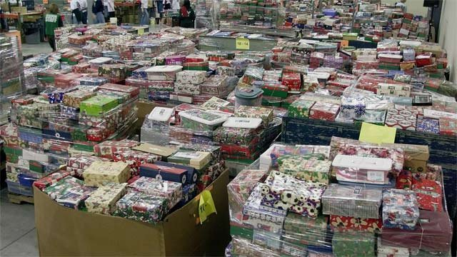 Crates of shoebox gift packages at an Operation Christmas Child processing center. (File/Associated Press)