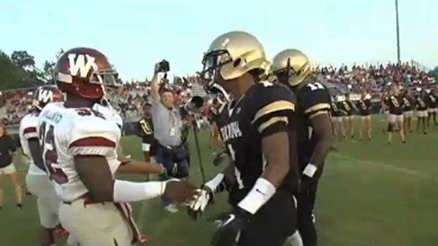 Westside and TL Hanna players shake hands at start of Nov. 8 game. (Nov. 8, 2013/FOX Carolina)