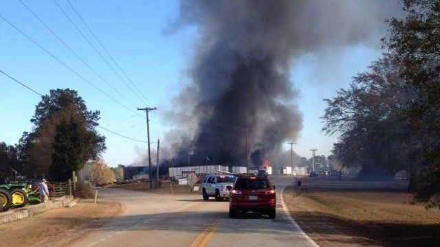 Smoke billows from the mill where the road is blocked to through traffic. (Nov. 20, 2013/FOX Carolina iWitness Brent Y.)