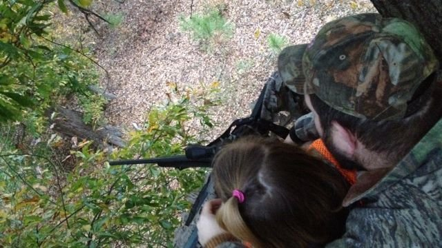 Autumn and her dad look out from their deer stand. (Nov. 20, 2013/FOX Carolina)