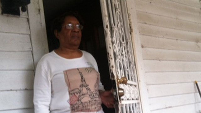 Shirley Rice stands at her front door two months after she was scammed. (Nov. 21, 2013/FOX Carolina)