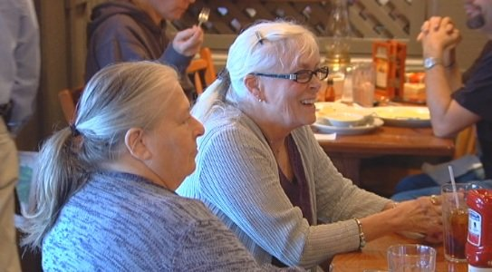 Nancy Jean Pearn (right) eats lunch with her newfound siblings. (Nov. 21, 2013/FOX Carolina)
