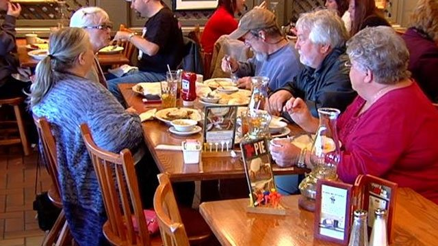 Nancy Jean Pearn (2nd from right) eats lunch with her newfound siblings. (Nov. 21, 2013/FOX Carolina)