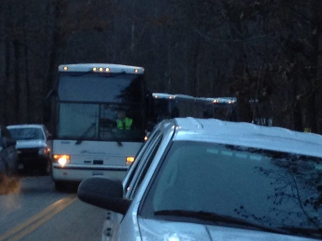 Buses are brought in to pick up the stranded passengers. (Nov. 25, 2013/FOX Carolina)