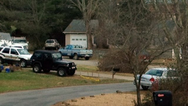 Deputies respond to the David Court area where the bodies were found at a home not pictured above. (Dec. 4, 2013/FOX Carolina)