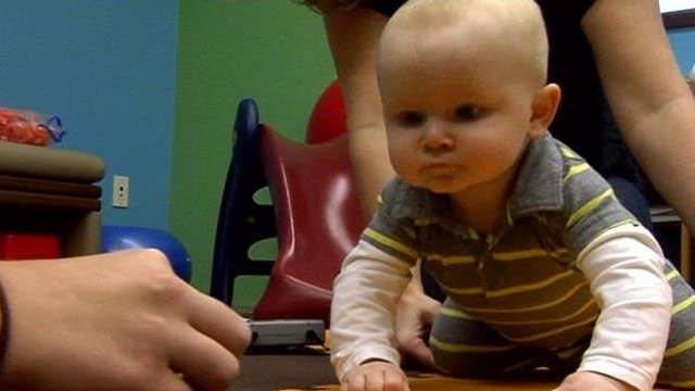 One-year-old Wyatt practices crawling at therapy. (Dec. 5, 2013/FOX Carolina)