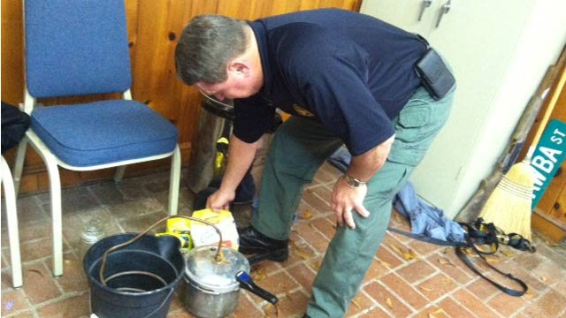 Sheriff Taylor showing FOX Carolina the still. (Dec. 6, 2013/FOX Carolina)