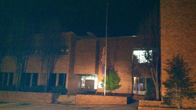 The flag in front of the Pickens Co. Sheriff's Office on Friday night. (Dec. 6, 2013/FOX Carolina)