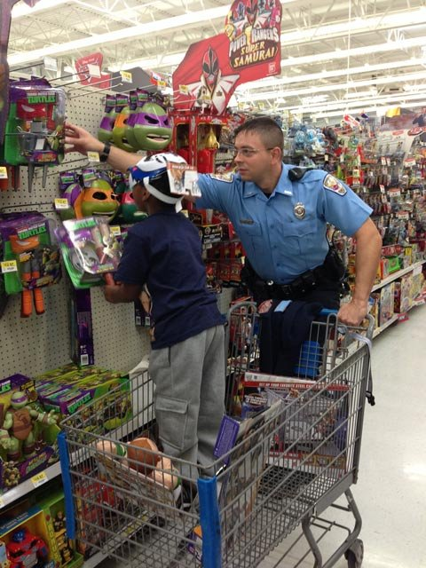 One of the kids picks out his toy with an officer. (Dec. 10, 2013/FOX Carolina)