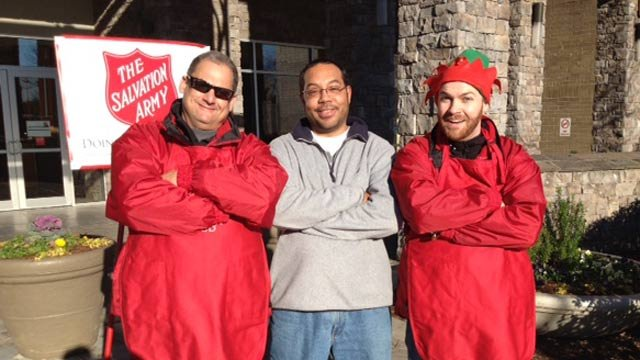Chris Scott and Joe Gagnon at the red kettle. (Dec. 11, 2013/FOX Carolina)