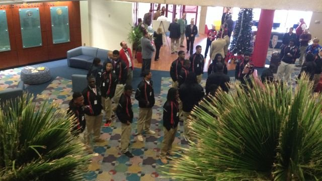 Players arrive at the Greenville Shriner's Hospital (Dec. 15, 2013, Fox Carolina)