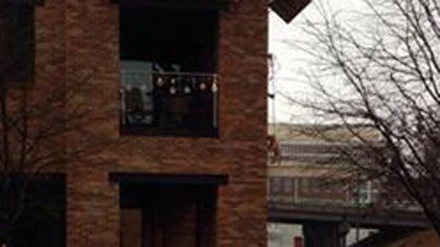 Several Facebook users sent us the picture of the dog suspended from a balcony in Greenville. (Source: Facebook)