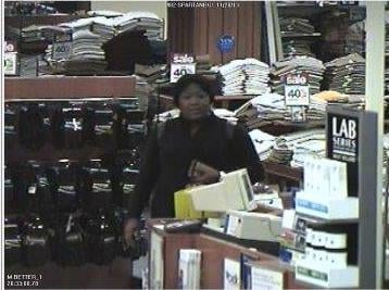 Surveillance pictures showing one of two women accused of financial transaction fraud. (Source: Greenville Police Dept.)