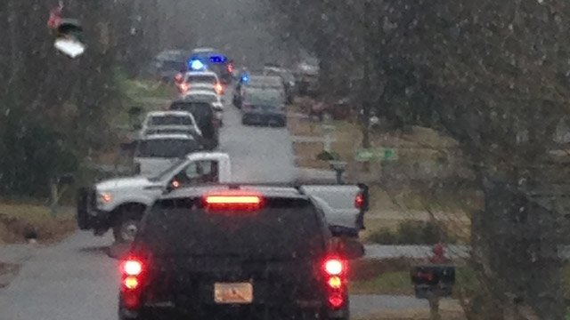 Oconee Co. deputies investigate a death and home invasion along Ames St. (Jan. 2, 2014/FOX Carolina)