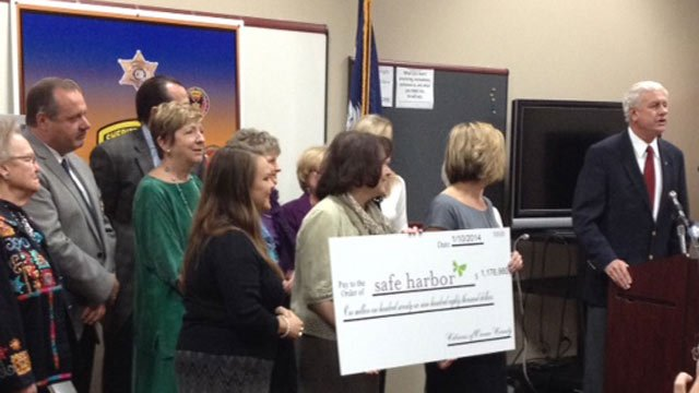 The million dollar check is given to Safe Harbor. (Jan. 10, 2014/FOX Carolina)