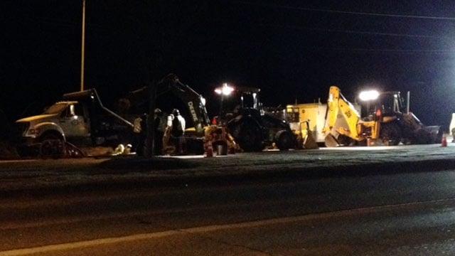 Crews work to repair a water line along U.S. 29 near Powell Mill Road. (Jan. 15, 2014/FOX Carolina)