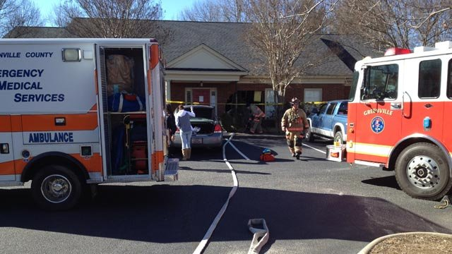 Emergency workers responded after the car went into the building. (Jan. 24, 2014/FOX Carolina)
