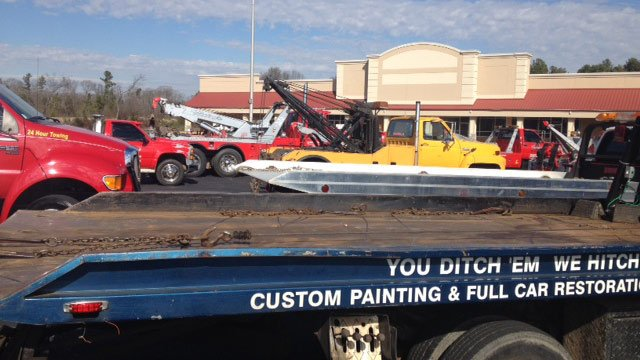 Tow trucks await Ellison's funeral procession. (Jan. 27, 2014/FOX Carolina)