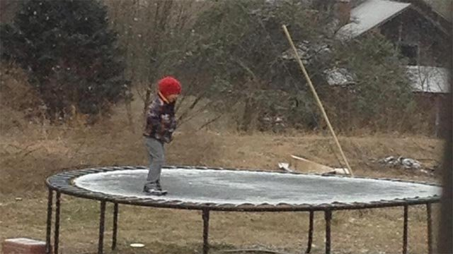 A child enjoys the first snow flurries. (Jan. 28, 2014/FOX Carolina iWitness Jessica P.)