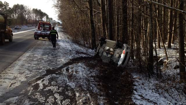 An overturned car along Poinsett Highway near Furman Univ. (Jan. 29, 2014/FOX Carolina)