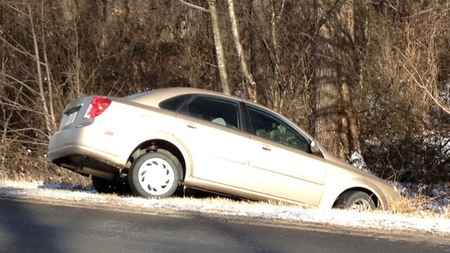 A car stuck off the side of Duncan Chapel Road. (Jan. 29, 2014/FOX Carolina)