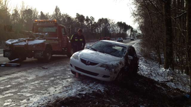 A car that rolled off an icy Upstate highway is towed. (Jan. 29, 2014/FOX Carolina)