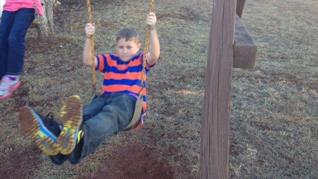 Eddie swings in the backyard after his four-wheeler was stolen. (Feb. 3, 2014/FOX Carolina)