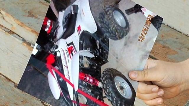 Eddie holds a photo of his four-wheeler. (Feb. 3, 2014/FOX Carolina)