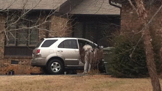A Kia Sorrento parked at the Dunbarton Court home where police say the driver was located. (Feb. 4, 2014/FOX Carolina)