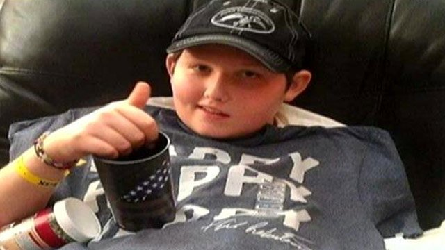 Logan Maney gives a thumbs up. (Source: Love for Logan Facebook page)