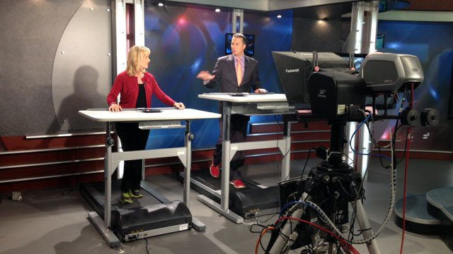 Cody and Diana deliver the news on the treadmill desks. (Feb. 4, 2014/FOX Carolina)