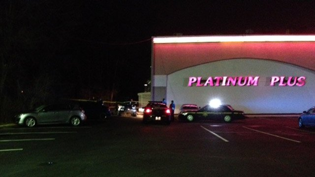 Deputies investigate the report of a shooting at Platinum Plus. (Feb. 11, 2014/FOX Carolina)