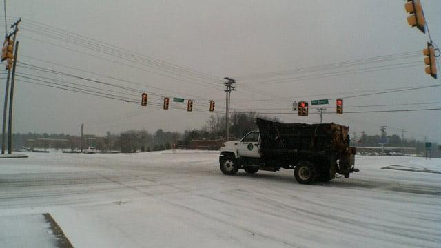 A snow-covered Woodruff Road at Roper Mountain Road. (Feb. 12, 2014/FOX Carolina)