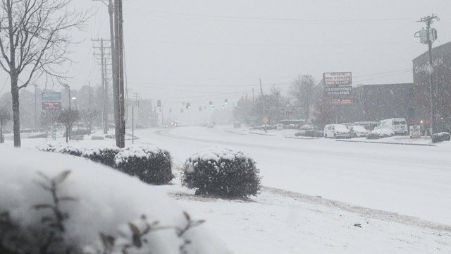 A snow-covered Woodruff Road at Roper Mountain Road. (Feb. 12, 2014/FOX Carolina)