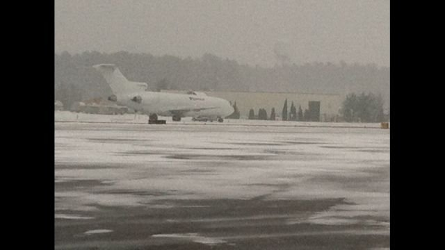 Snow crews battle the winter storm at GSP Intl. AIrport (Fox Carolina)