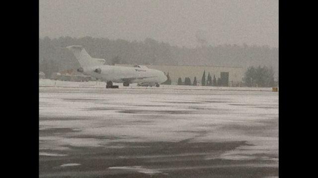 Snow crews battle the winter storm at GSP Intl. AIrport (Fox Carolina)