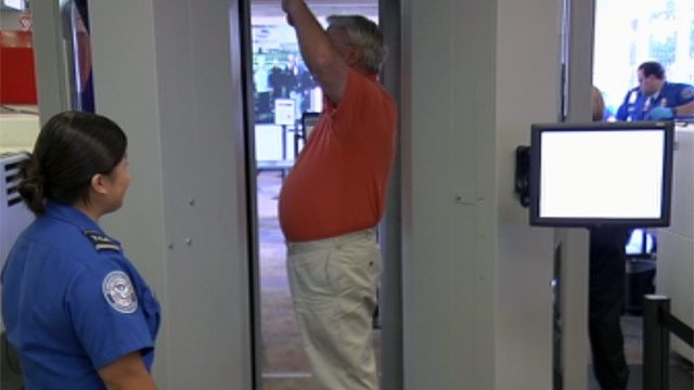 A TSA agent goes through the body scanner at GSP. (June 21, 2012/FOX Carolina)